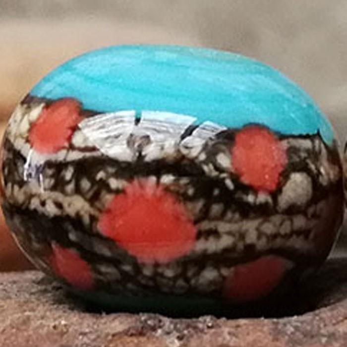 turquesa claro con franja marfil oscuro y puntos naranjas coral