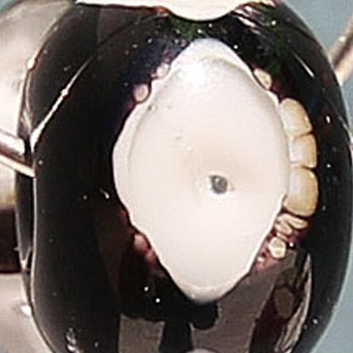 negro con punto marfil claro, burbuja y punto transparente