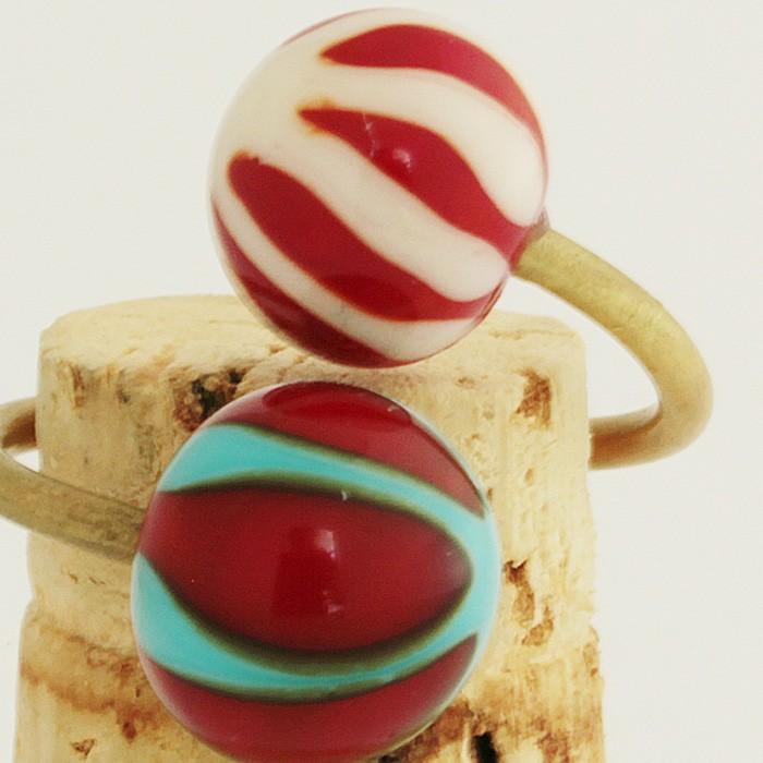 rojo pintalabios con asterisco marfil claro-rojo pintalabios con asterisco turquesa claro