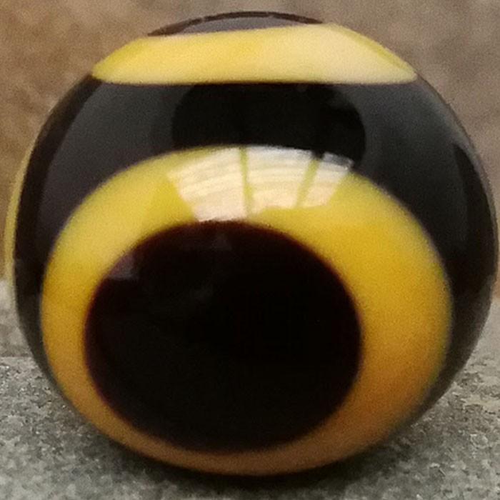 negro con puntos amarillo vainilla y negros superpuestos
