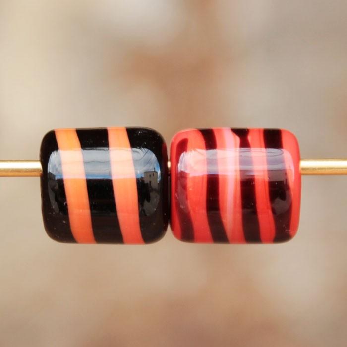 cilindros Naranja coral con espiral negra y Negro con espiral naranja